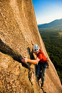 A man rock climbing near the top of Cathedral Ledge. Echo Lake State Park, White Mountains, in North Conway, New Hampshire, USA. October 2009, Model released  -  Jerry Monkman