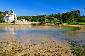 Niembro Bay with church and cemetery of Los Dolores at low tide, near Llanes, Asturias, Spain. July 2009 - Nick Upton