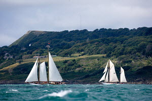 """Schooner """"Rebecca of Vineyard Haven"""" (left) and gaff ketch """"Eileen II"""" sailing at the British Classic Yacht Club Cowes regatta, Isle of Wight, UK. July 2009. - Richard Langdon"""