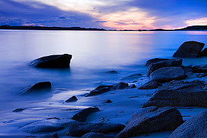 Rocks and swash on Old Quay Beach at dusk, St. Martin's, Isles of Scilly. January 2010.  -  Merryn Thomas