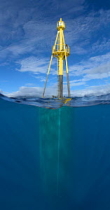 Large wave-energy buoy off Kaneoho Bay, Oahu. The 40-kW experimental buoy employs the bobbing motion of the buoy to drive an electrical generator, that sends power to the island via underwater cable,... - David Fleetham
