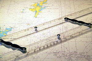 Parallel rules on navigation chart aboard trawler on the North Sea, 2010.  -  Philip Stephen
