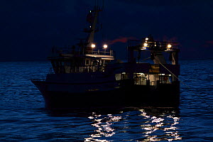 "Fishing vessel ""Harvester"" trawling at twilight on the North Sea. February 2010, Property released.  -  Philip Stephen"