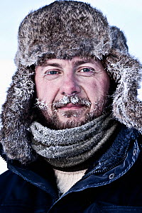 Head portrait of photographer Uri Golman in temperatures of -40 degrees celsius, with frost in his beard. Greenland. March 2009. Model released - Uri Golman