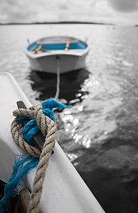 Tender tied to small motorboat off St. Martin's, Isles of Scilly, UK  -  Merryn Thomas