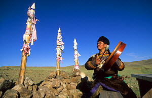 Buriat shaman plays tambourine on Olkhon Island, Baikal lake, Siberia, Russia, June 2000  -  Eric Baccega