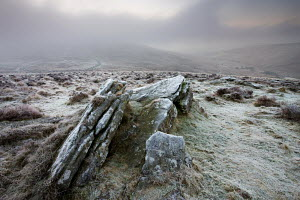 Frost covered moorland looking down onto the circular walled bronze-age settlement of Grimspound, Dartmoor National Park, Devon, England. January 2009 - Adam Burton