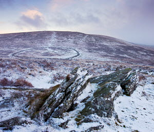 Snow covered rocky moorland landscape overlooking the bronze age walled settlement of Grimspound, Dartmoor National Park, Devon, England. January 2009 - Adam Burton