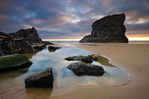 Bedruthan Steps, at low tide with stormy sky, Cornwall, England. May 2009  -  Adam Burton