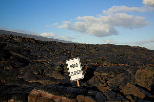 Lava flow over the Chain of Craters Road, with road closed sign, Hawai'i Volcanoes National Park. The Big Island of Hawaii, USA, December 2008  -  Kirkendall-Spring