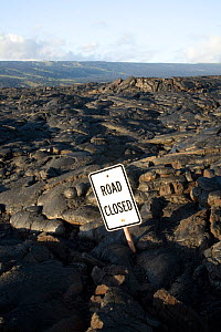 Lava flow over the Chain of Craters Road, with road closed sign, in Hawai'i Volcanoes National Park. The Big Island of Hawaii, USA, December 2008  -  Kirkendall-Spring