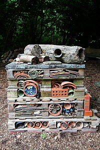 """""""Insect Home"""" in a garden. Created with pallets, bricks, pots, stones, bark and piping. Used by insects such as ladybirds, bees and lacewings and amphibians to hibernate over winter. Sussex, England,...  -  Simon Colmer"""