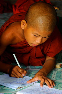 Young buddhist monk studying in a monastery, Taungoo, Central Myanmar (Burma). September 2009  -  Inaki Relanzon