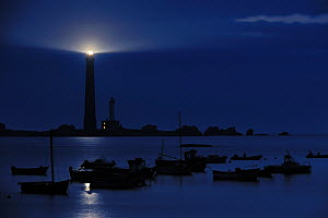 Fishing boats and lighthouse at night on the island Ile Vierge, Brittany, France, June 2009  -  Philippe Clement