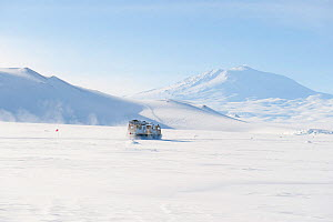 Haagland tracked vehicle crossing the sea ice, Ross Sea, McMurdo Sound with Mt Erebus in the background, Antarctica, November 2008  -  Neil Lucas