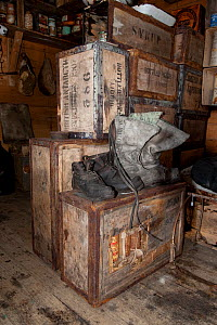 Boots and wooden packing cases in interior of Shackleton's Nimrod Hut, frozen in time from the British Antarctic Expedition 1907, Cape Royds, McMurdo Sound, Antarctica, November 2008  -  Neil Lucas
