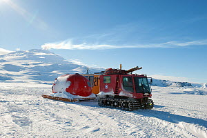 Tracked vehicle towing a hut and gas cylinder to ice hole for the BBC film crew, Piston Bully, Ross Sea, McMurdo Sound, Antarctica, November 2008  -  Neil Lucas