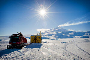 Dive hut and track vehicle for BBC film crew, McMurdo, Ross Sea, Antarctica,  Mt Erebus in the background, November 2008 - Neil Lucas