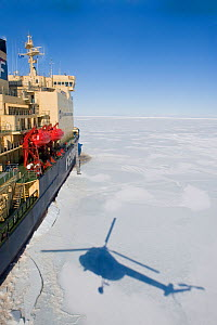 Shadow of helicopter returning to the Russian ice breaker ship, Kapitan Khlebnikov, McMurdo Sound, Ross Sea, Antarctica, November 2008  -  Neil Lucas