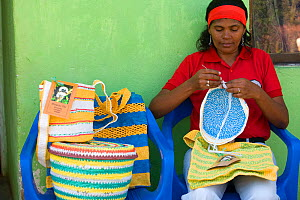 Colombian woman knitting mochilas and other products woven from recycled plastic bags. This project has recycled more than 1.5 million plastic bags and provides an income to the village living around...  -  Lisa Hoffner