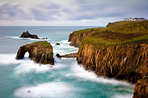 View of waves crashing against the cliffs at Land's end, Cornwall, England, UK. March 2010.  -  Ross Hoddinott