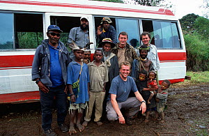 BBC Producer, Huw Cordey, and cameramen, Paul Stewart and Tom Clarke, with Huli people, Tari Valley, Papua New Guinea during filming of BBC series Planet Earth, August 2004.  -  Tom Clarke