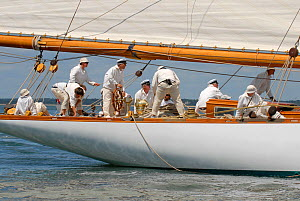 """Crew members all in white on the aftdeck of gaff cutter """"Mariquita"""". Westward Cup Regatta, Cowes, Isle of Wight. July 2010.  -  Rick Tomlinson"""