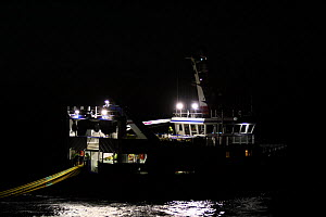 "Fishing vessel ""Harvester"" hauling fishing gear in the dark, May 2010. Property released. - Philip Stephen"