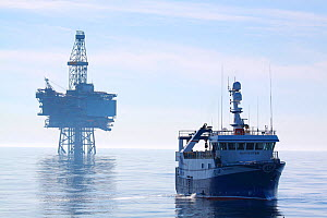 "Fishing vessel ""Harvester"" and the ""Jotun B"" oil production platform. North Sea, May 2010.  -  Philip Stephen"