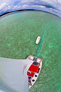 "View from the masthead of 30ft Tiki catamaran ""Abaco"". Exumas, Bahamas, Caribbean. June 2009, Model and property released.  -  Onne van der Wal"