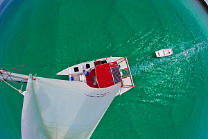 "View from the masthead of 30ft Tiki catamaran ""Abaco"", underway in the Exumas, Bahamas, Caribbean. June 2009, Model and property released.  -  Onne van der Wal"