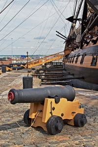 "Cannon on wharf beside ""HMS Victory"" at Historic Naval Dockyard, Portsmouth, England, July 2010. Editorial use only. - Norma Brazendale"