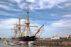 """HMS Warrior"" berthed at Historic Naval Dockyard, with small boats anchored alongside. Portsmouth, England, July 2010. Non-editorial uses must be cleared individually. - Graham Brazendale"