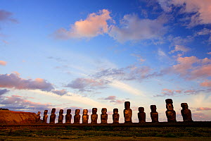 Silhouette of giant moai statues in Ahu Tongariki with Poike Peninsula in the background, Easter Island, Pacific ocean, November 2004  -  Oriol Alamany