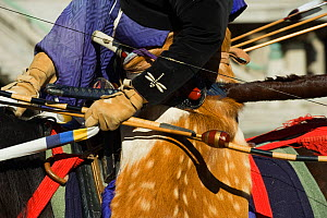 Details of costume of a traditionally dressed samurai (warrior) from the Takeda School of Horseback Archery with bows and arrows, during a Yabusame (Japanese mounted archery), at Meiji Jingu Shrine, T... - Kristel Richard