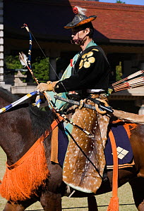 Traditionally dressed samurai (warrior) from the Takeda School of Horseback Archery with bows and arrows, during a Yabusame (Japanese mounted archery), at Meiji Jingu Shrine, Tokyo, Tokyo Prefecture,...  -  Kristel Richard