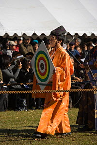 At the start of a Yabusame (Japanese mounted archery event), the target is put in place by a member of the Takeda School of Horseback Archery, at Meiji Jingu Shrine, Tokyo, Tokyo Prefecture, Japan. 20... - Kristel Richard