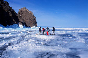 Film crew digging hole in ice for cameramen to dive in Lake Baikal, world's deepest and oldest (and largest by volume) freshwater lake, Siberia, Russia on location for BBC Planet Earth series, April 2... - Mark Brownlow