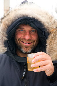 Photographer Steven Kazlowski enjoys a scotch after a long day, during an expedition to photograph wildlife in Svalbard, Norway. August 2009  -  Steven Kazlowski