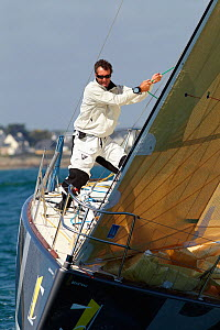 """Skipper Jeremie Beyou hoisting spinnaker on board """"BPI"""" during La Solitaire du Figaro, Port la Foret Le, Brittany, France, 2010. All non-editorial uses must be cleared individually.  -  Benoit Stichelbaut"""