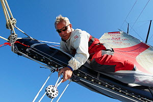 """Skipper Roland Jourdain attending to the mainsheet tackle on board """"Veolia Environment 2"""", during qualification for 2010 Route du Rhum, France, 2010. All non-editorial uses must be cleared individuall...  -  Benoit Stichelbaut"""