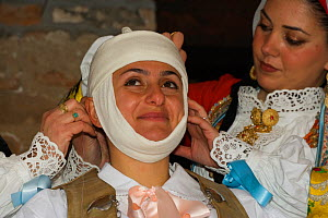 During the dressing of the Gremio di Falegnami, 'Su Cumponidori' the head of the 'Sartiglia' (race to the star) is officially dressed in the traditional costume  in Oristano, Sardinia, Italy. February...  -  Kristel Richard