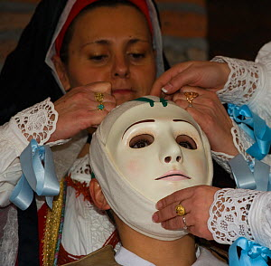 During the dressing of the Gremio di Falegnami, 'Su Cumponidori' the head of the 'Sartiglia' (race to the star) is officially dressed in the traditional costume and mask in Oristano, Sardinia, Italy....  -  Kristel Richard