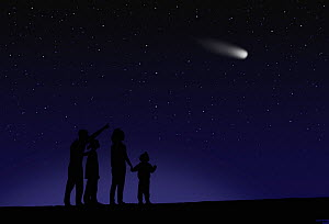 A family observing a comet in the night sky.  -  Visuals Unlimited