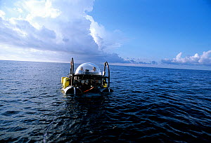 DeepSee diving submersible at water's surface, being towed, Cocos Island, Costa Rica, Pacific Ocean. Property released Model released. - Jeff Rotman