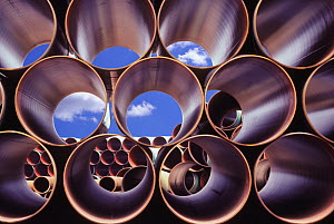 Heavy duty welded steel pipes stockpiled for the construction of an under sea oil pipeline.  -  Visuals Unlimited