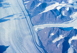 Aerial view of the confluence of a tributary glacier and a major valley glacier, Greenland. Note the pattern of their moraines.  -  Visuals Unlimited