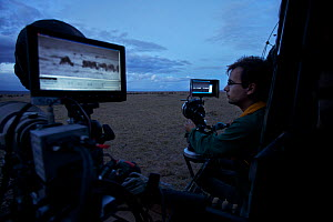 """Alex Verner in filming vehicle operating thermal cameras, on location for """"Night of the Lion"""", 2009. Can only be used if National Geographic """"Night of the Lion"""" is mentioned  -  Martin Dohrn"""