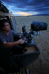 """Martin Dohrn operating camera for filming at night, Masai Mara, Kenya, 2009, Can only be used if National Geographic """"Night of the Lion"""" is mentioned.  -  Martin Dohrn"""