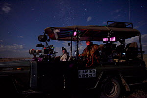 Alex Verner and Clinton Edwards in filming vehicle by moonlight, on location for ^Night of the Lion^, 2009. Thermal camera technology was used to film lions at night.~Can only be used if National Geog... - Martin Dohrn